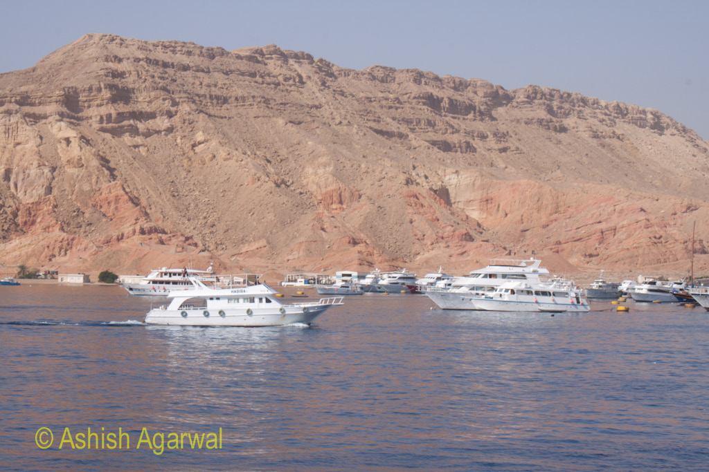 Ships buzzing near the shore at the town of Sharm el Sheikh in the Red Sea in Egypt