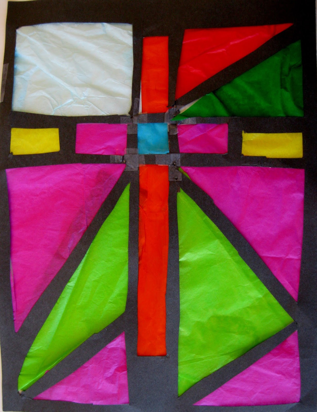 tissue paper stained glass Spring stained glass window kite decorations made from tissue paper and clear  contact paper this kindergarten teacher shares instructions in.