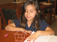 Student showing a cube she made with toothpicks