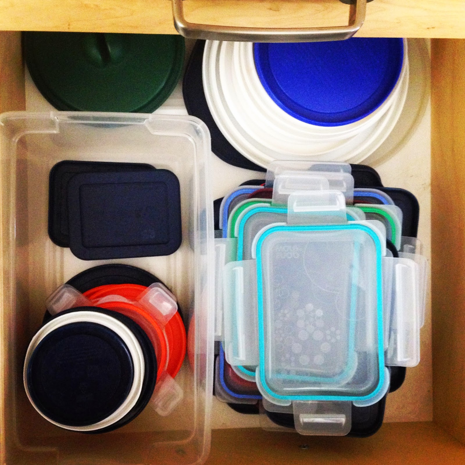 Organized lids in the drawer :: OrganizingMadeFun.com