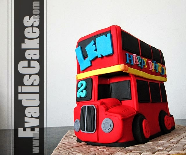 Side view picture of London bus sculpture cakes