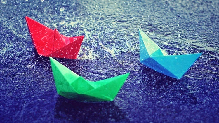 Red, Blue Green Paper Boats in Rain