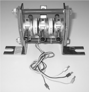 Two flat-pack thyristors mounted on a liquid-cooled heat sink
