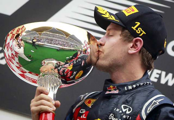 Sebastian Vettel Kisses his first place trophy after claiming victory at the First Indian Formula One Grand Prix