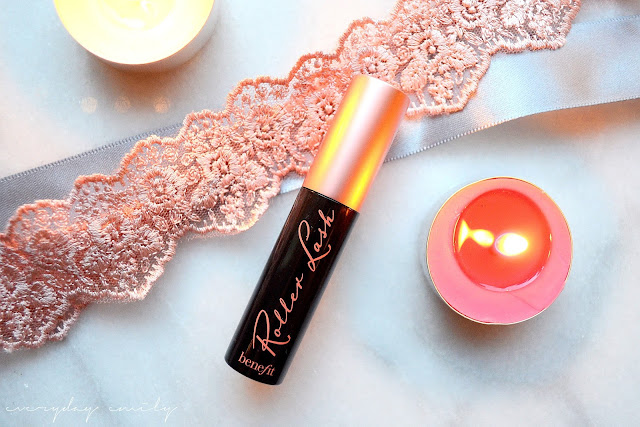 Benefit's Roller Lash, a small black mascara tube sitting on top of ribbons
