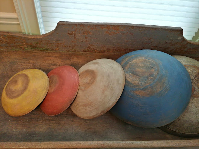 Newer wood bowls painted and distressed to look old.
