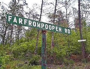http://www.funnysigns.net/farfrompoopen-road/
