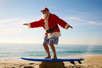 Santa on surfboard (Credit: Shutterstock) Click to Enlarge.