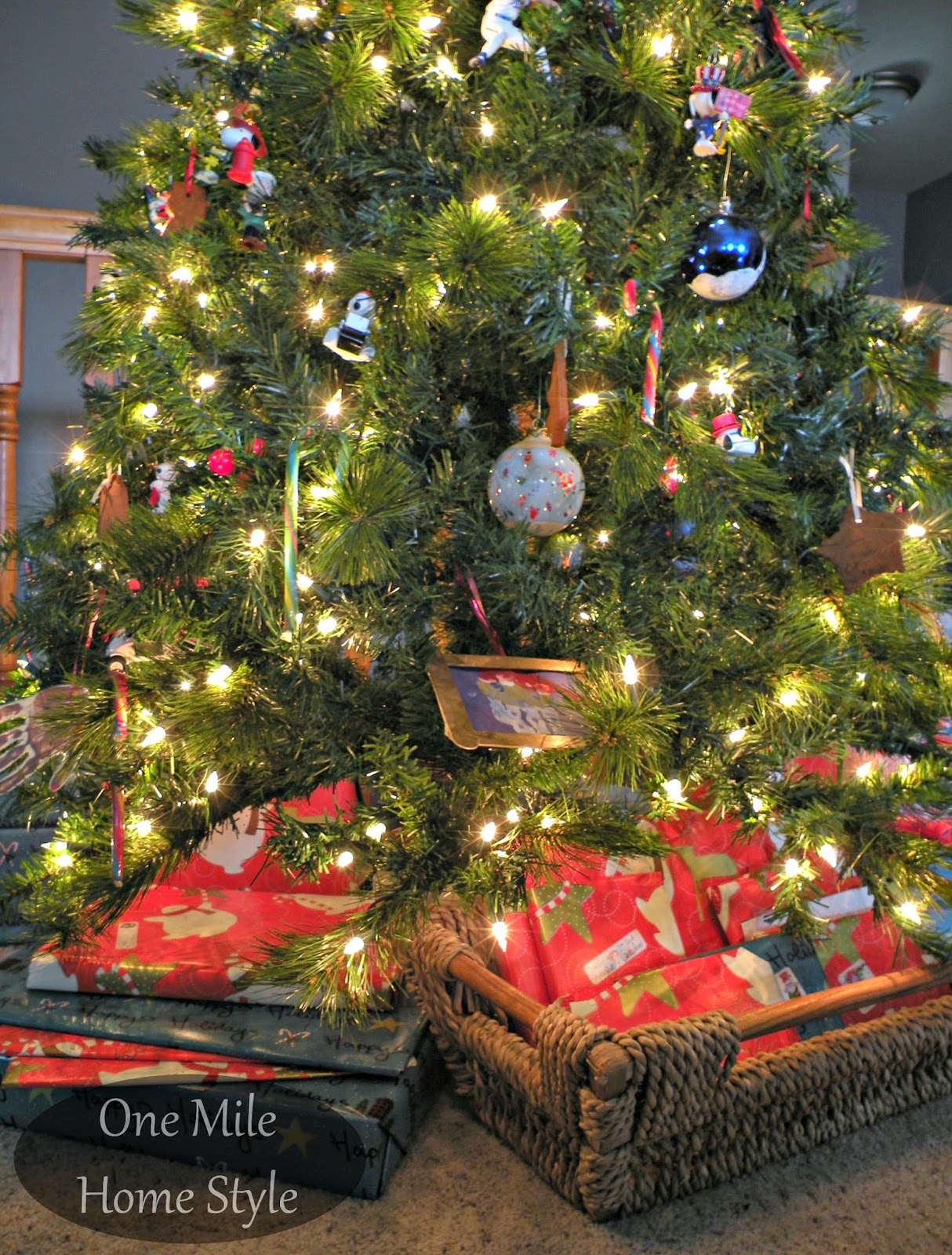 One Mile Home Style Christmas Tree 2014 - Using a basket to hold small gifts under the tree