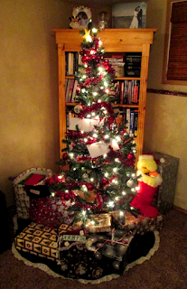 Christmas tree with letters, stockings, and presents