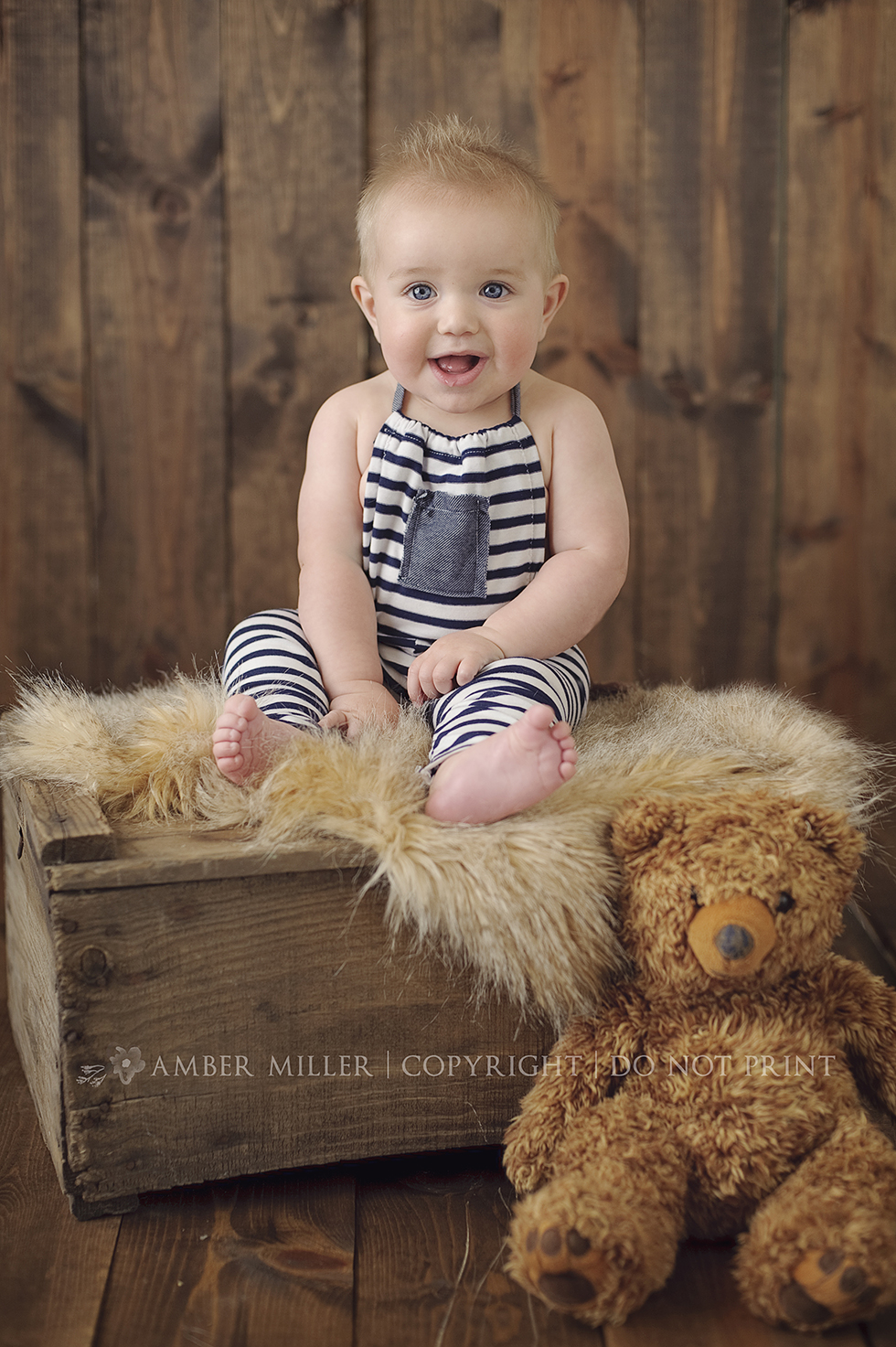 baby boy with teddy bear portrait