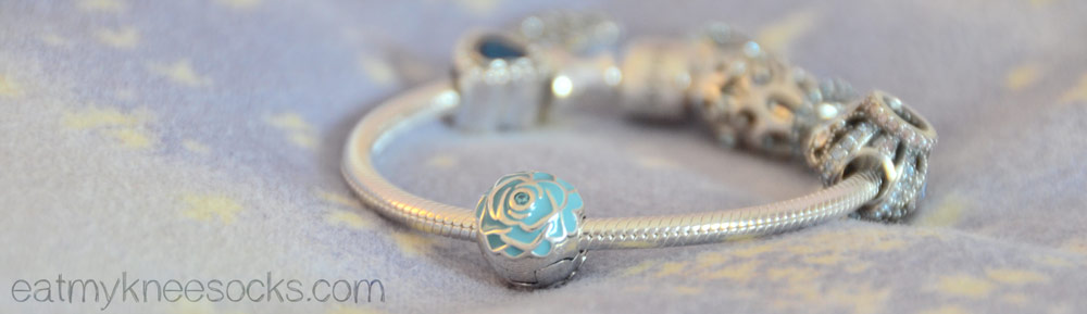 Soufeel's blue rose clip charm is a light turquoise color with a blue crystal in the center of the rose.