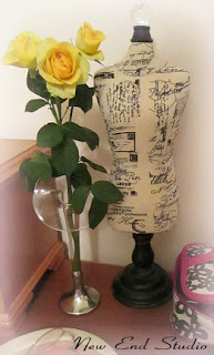 yellow roses in a bud vase
