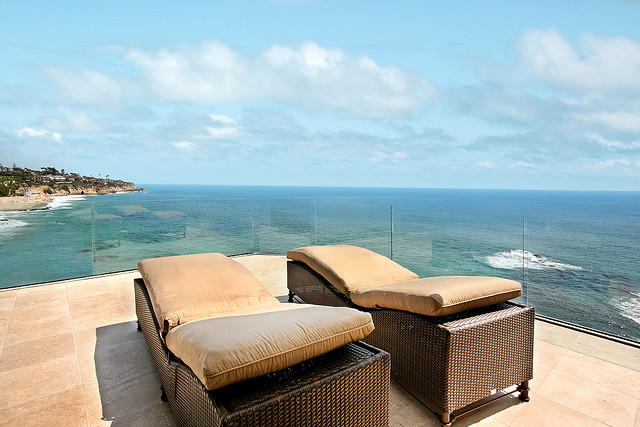 Photo of two outdoor beds overlooking the ocean on the terrace