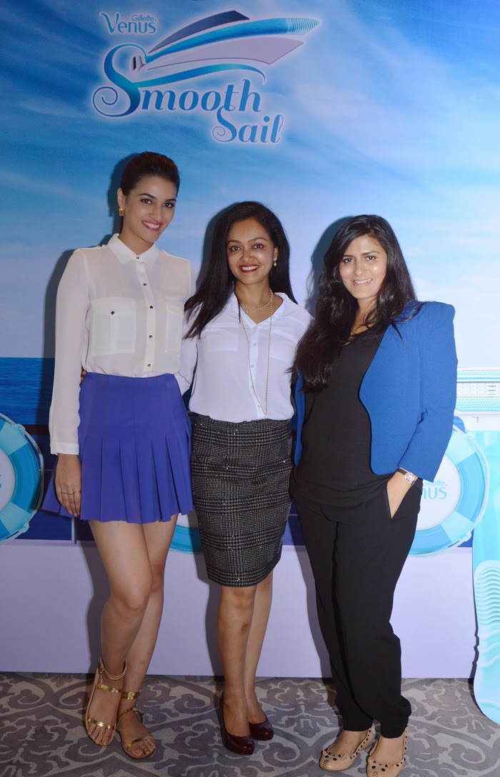 Bollywood actress Kriti Sanon, dermatologist Dr. Rashmi Shetty and celebrity makeup artist Namrata Soni pose in front of the press board for Gillette Venus' Smooth sailing event