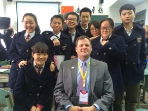 Mr. Willard with private school students in the classroom