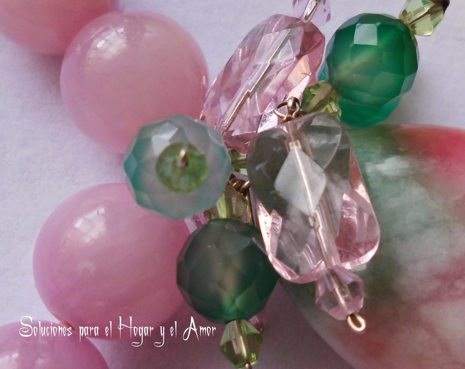 Cristales de Cuarzo rosa en esferas y cristales de swaroski