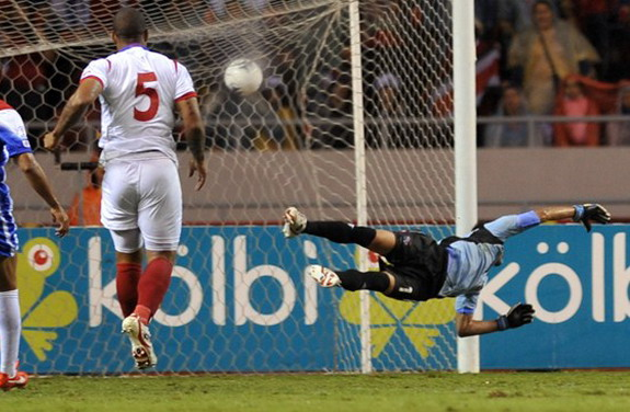 Costa Rica player Celso Borges scores his side's second goal against Panama