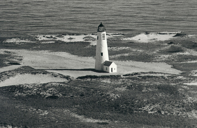The current, third lighthouse at Great Point, built after the previous lighthouse was destroyed by a nor'easter on 29 March 1984. Photo by Flint Ranney, 1986. Source: Nantucket Historical Association