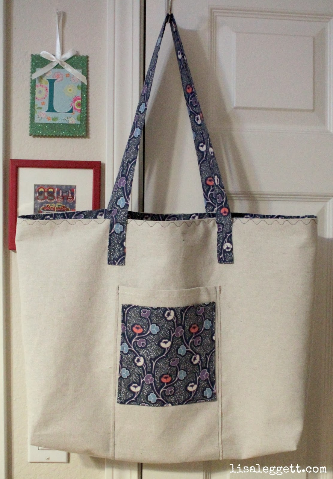 Large canvas tote with matching pocket, handles and interior.