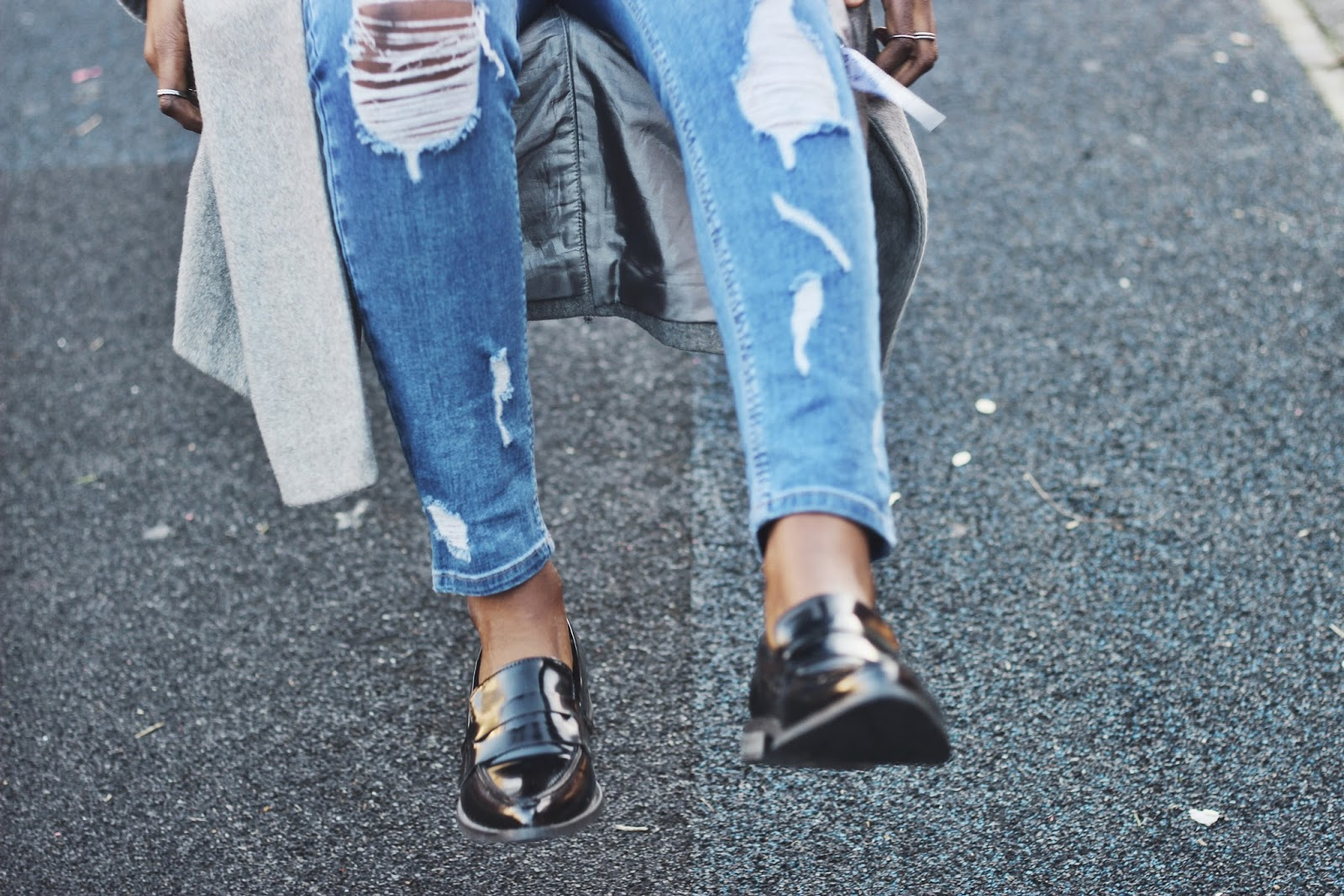 Blue ripped skinny jeans and black pointed patent loafers