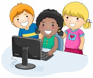 a small group of children using a computer
