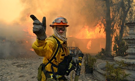 A fireman calls for more water to douse a fire raging through a home in Glendora. (Credit: Will Lester/Corbis) Click to enlarge.