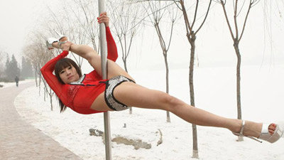 Pole Dancers In China Perform In The Snow