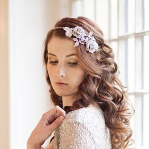 The lovely colorful tiaras with the matchingrhinestones, pearls, and