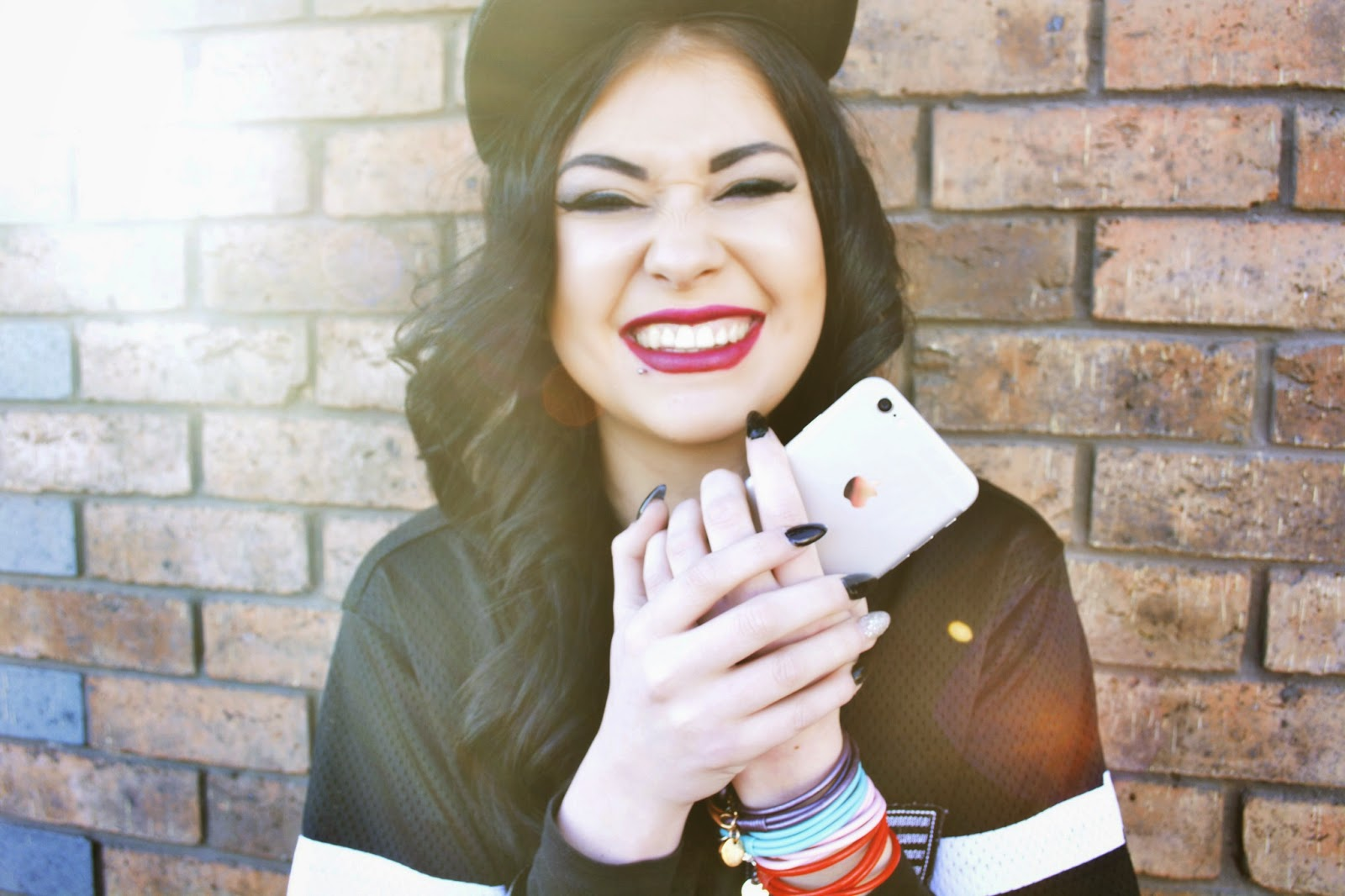 laughing girl image, black nails and red lipstick