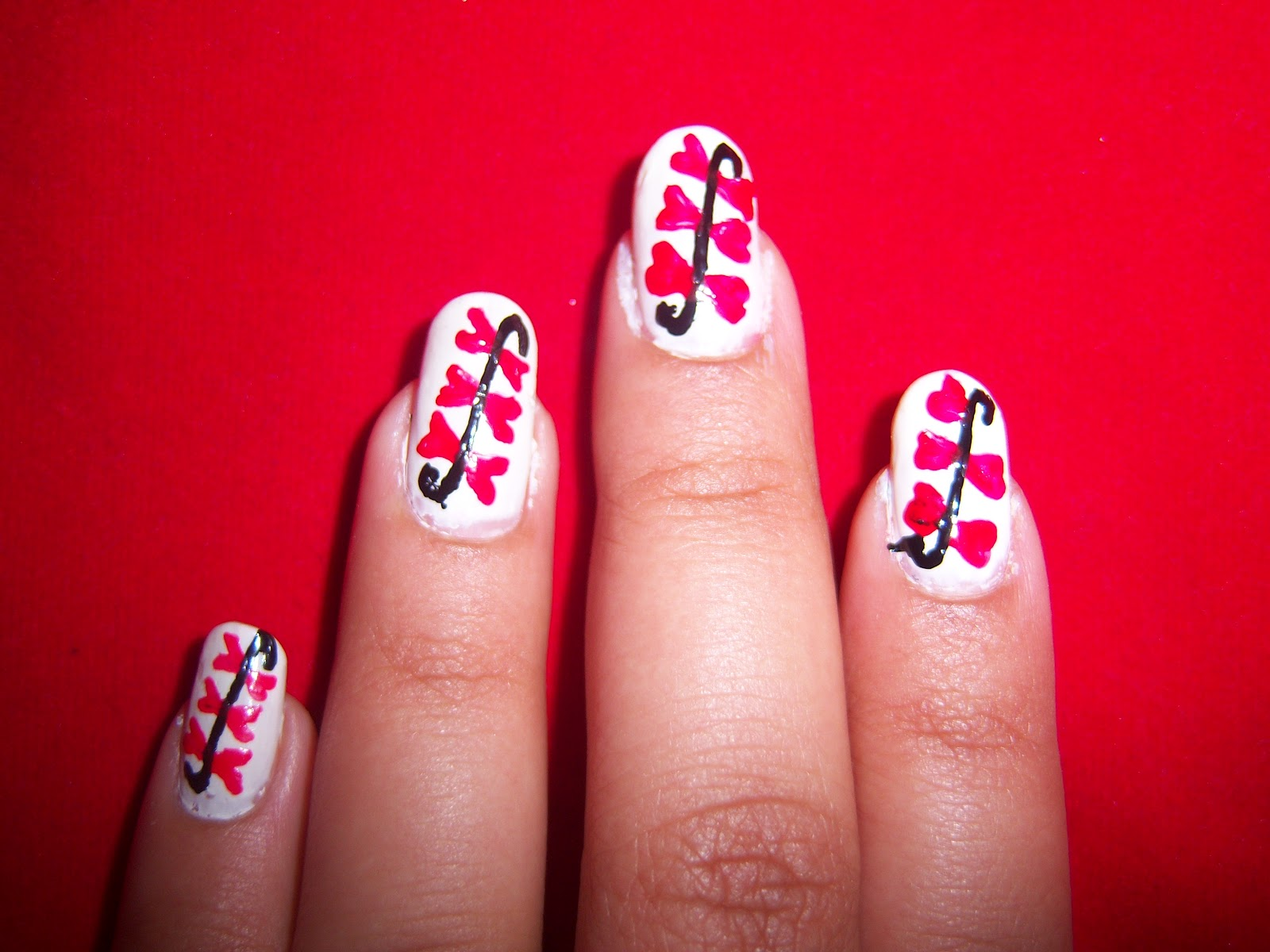 Saipriya Patel: Red amp; White nail art design