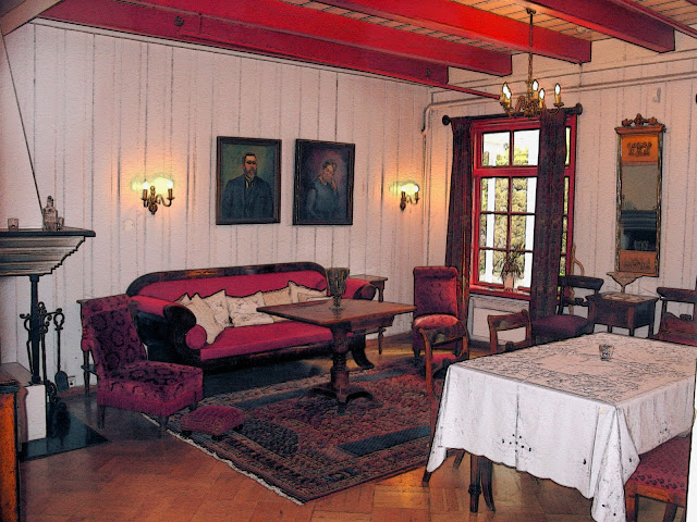 Marthe's living room appears as it was when she was alive. You can see her portrait above the couch.