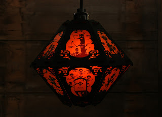 Twelve panel paper and vellum lantern in orange and black