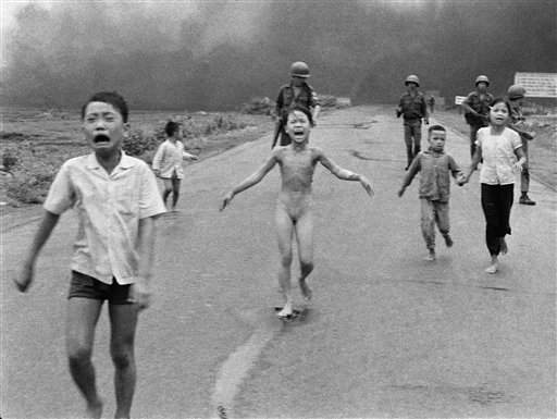 Iconic photo of crying Vietnamese children after an aerial napalm attack near near Trang Bang, Vietnam, June 8, 1972, Photo by Nick Ut / AP.