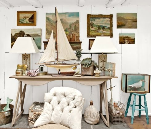 Rustic white washed sea cottage built from a ship for Vintage ocean decor
