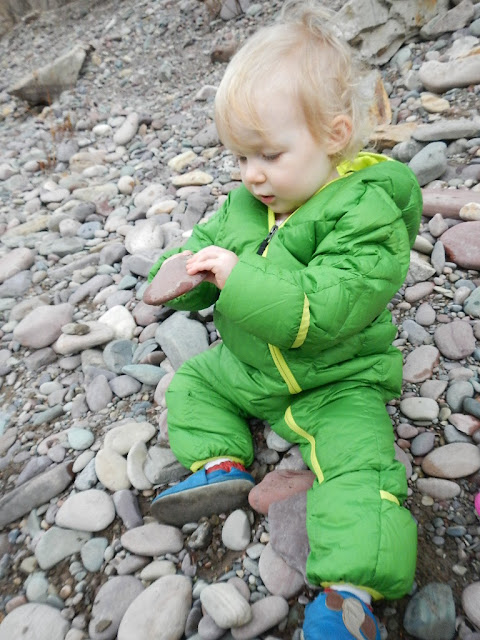 toddler exploring rocks and nature blackfoot river montana