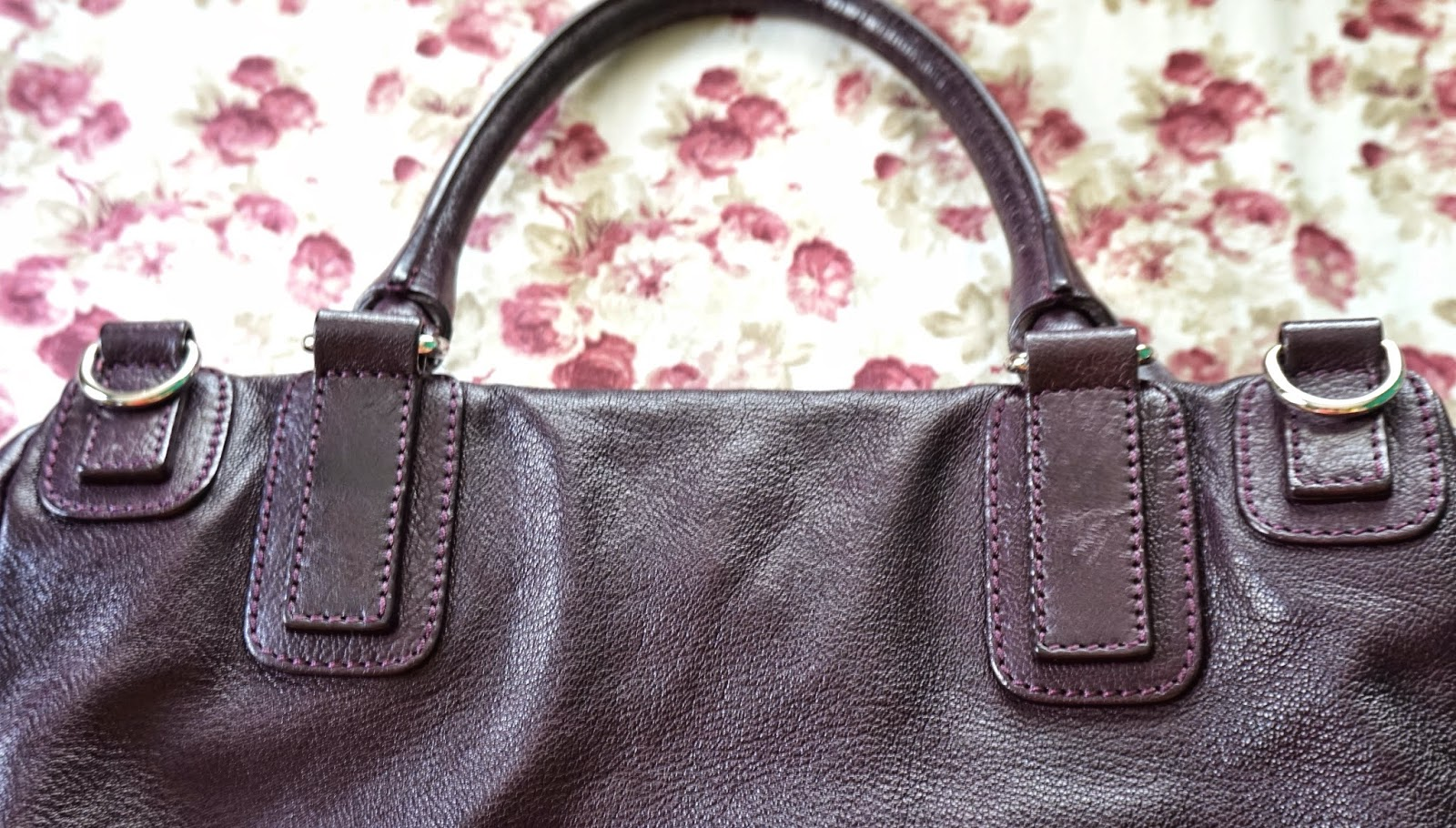 57e1afc5768f The handle is reinforced on four leather patches on the bag  two that serve  as anchors for the handle