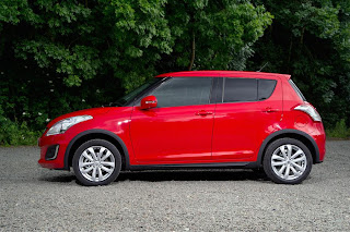 Suzuki Swift SZ4 4x4 (2013) Side