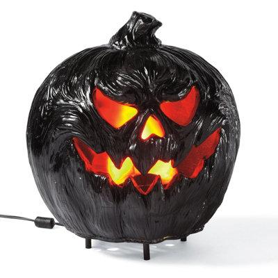 flaming black charred pumpkin - Halloween Haven