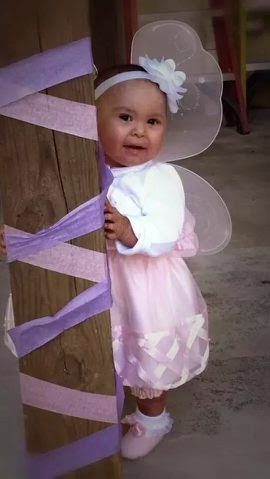 Brooklyn, who has Ichthyosis, dressed up in fairy wings