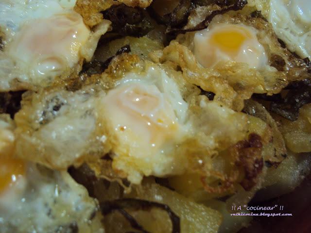 Patatas a la provenzal con huevos de codorniz