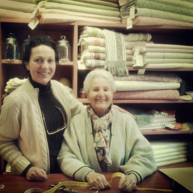 Mother and daughter team inside their tailor shop in Montalcino