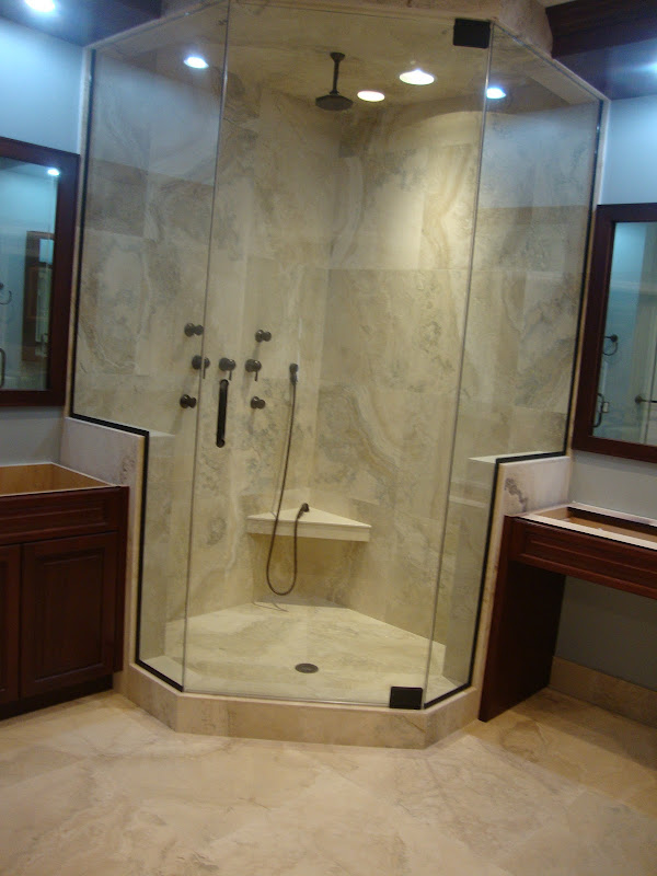 Master Bathroom Shower in Italian Travertine by KG Marble Designs Inc. title=