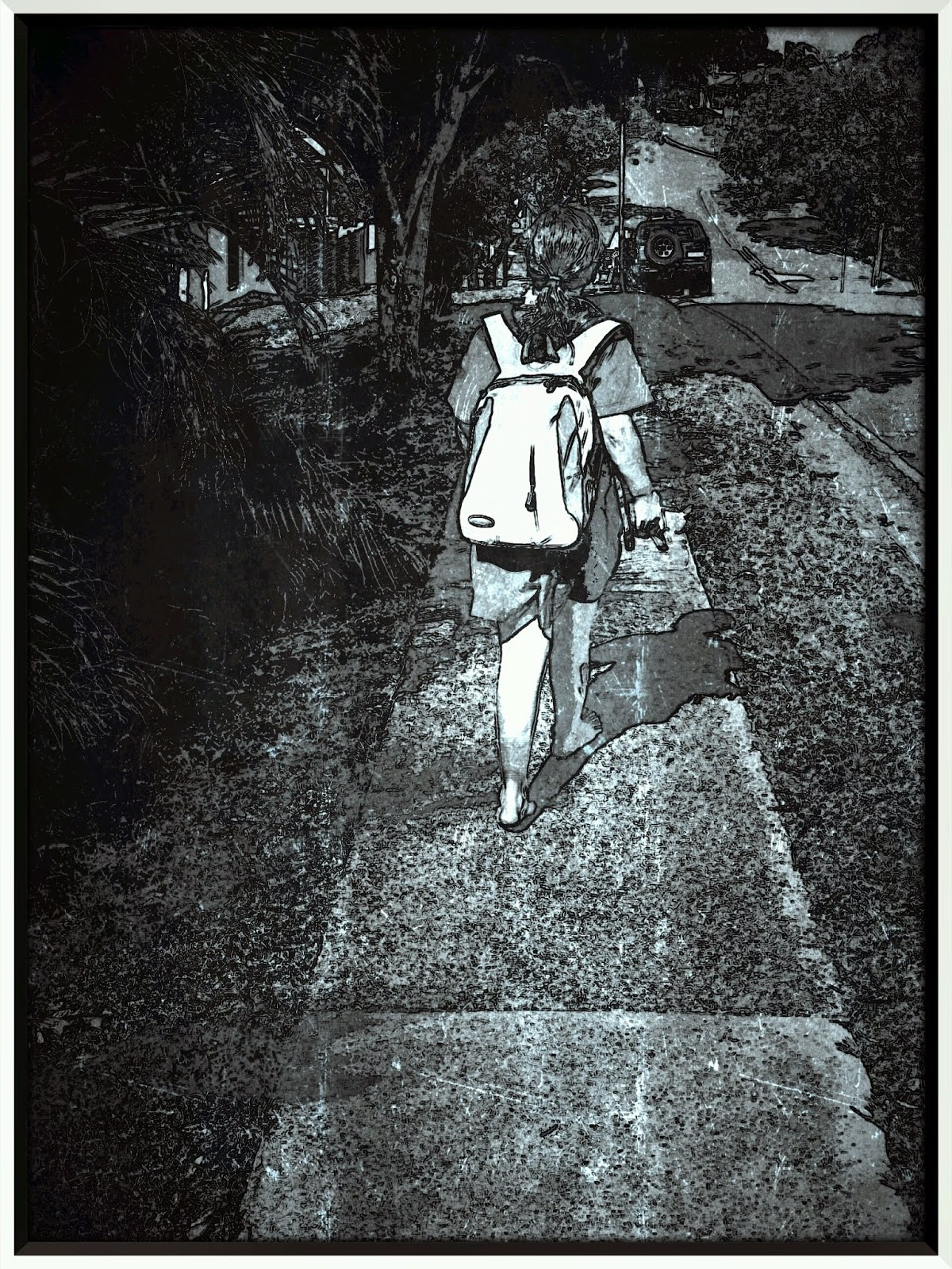 black and white photo of child walking barefoot