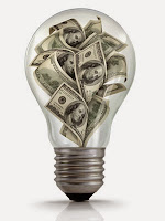 Illustration of a clear light bulb filled with dollar bills