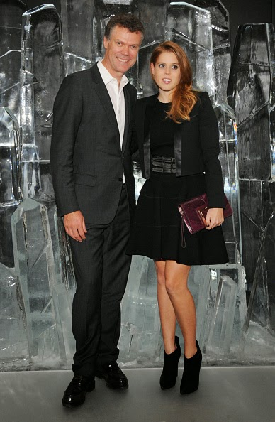 Pierre Denis, CEO of Jimmy Choo, and Princess Beatrice of York attend the dinner hosted by Sandra Choi, Creative Director of Jimmy Choo, to unveil Jimmy Choo's new VICES collection and installation by British artist Mat Collishaw at One Mayfair on 09.10.2014 in London, England.