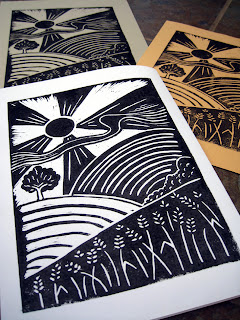 Black and white lino print corn fields landscape.