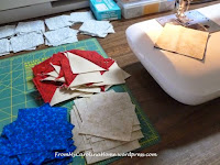 https://frommycarolinahome.wordpress.com/2015/03/30/chain-piecing-half-square-triangles/