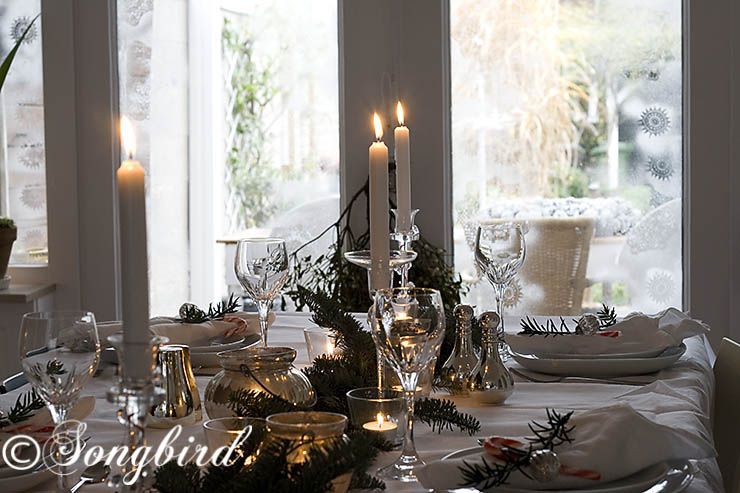 Sparkly Christmas table setting in silver and green