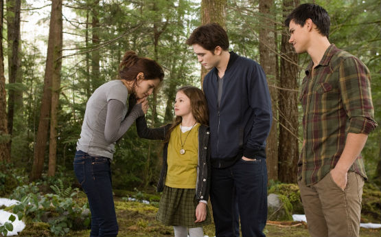 The Twilight Saga: Breaking Dawn Part 2 the Cullens in the woods movieloversreviews.blogspot.com